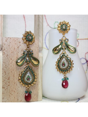 https://static1.cilory.com/8650-thickbox_default/elegant-temple-shape-earrings-carved-in-stone.jpg